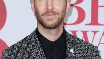 Ivy League haircut: Calvin Harris with a dark blonde Ivy League haircut, wearing a patterned blazer and a black shirt