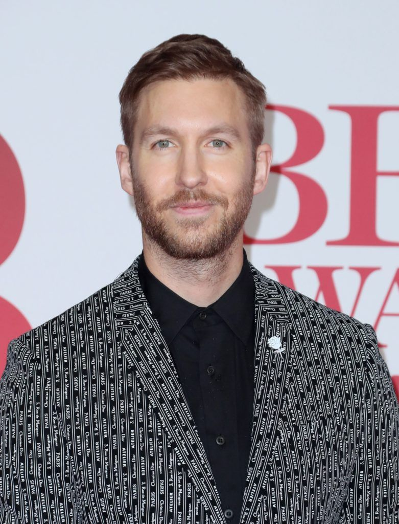 Ivy League haircut: Calvin Harris with a dark blonde Ivy League haircut, wearing a patterned blazer and a black shirt