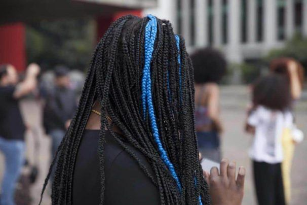 Woman wih dark brown marley twists with accent blue colour