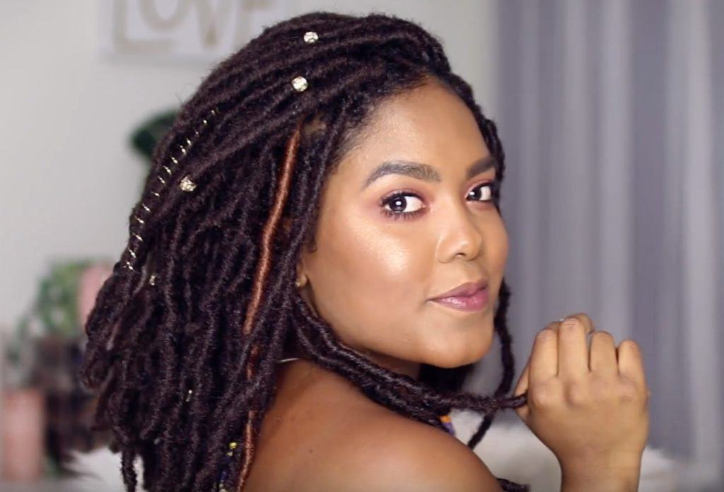 Woman with medium length marley twists with accent hair colours