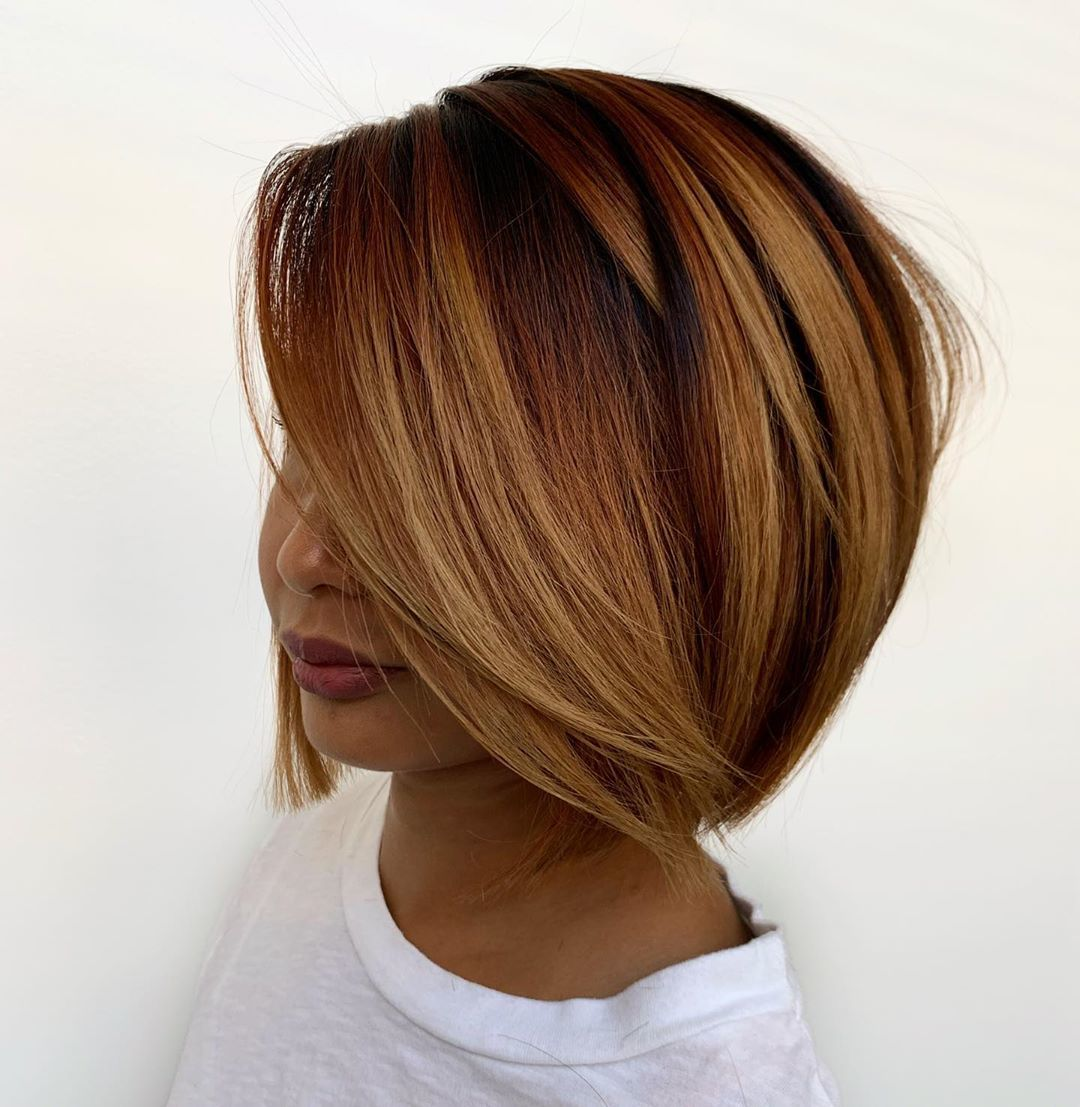 Woman with short layered copper bob