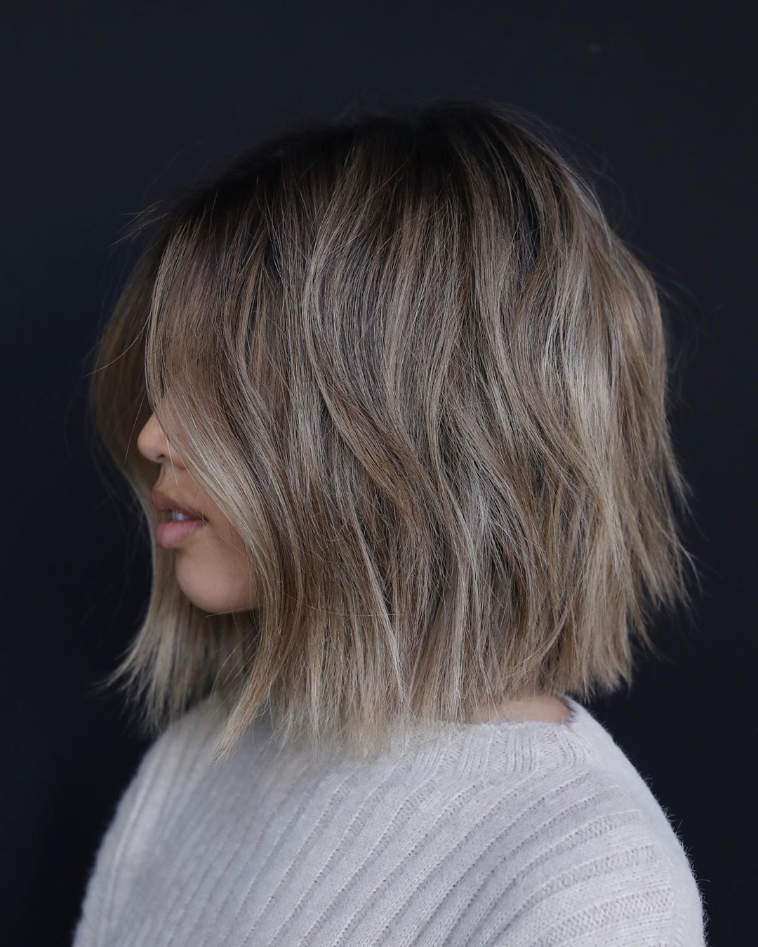 Woman with ash brown medium bob with lived-in layers