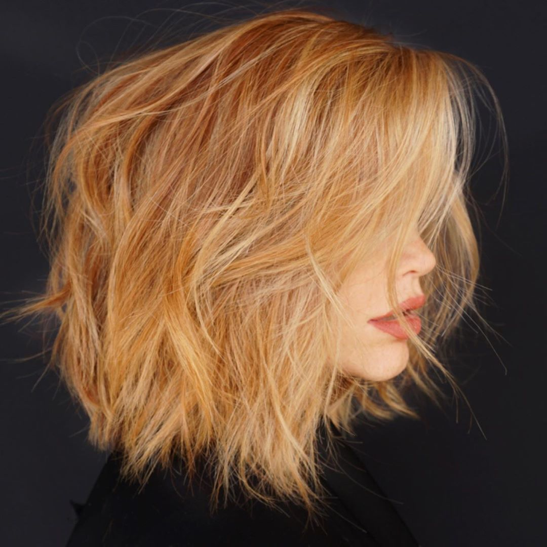 Woman with messy orange layered short haircut