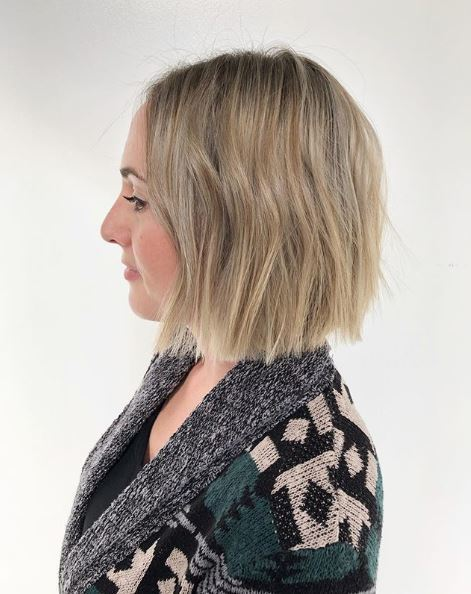 Woman with choppy bob on fine blonde hair