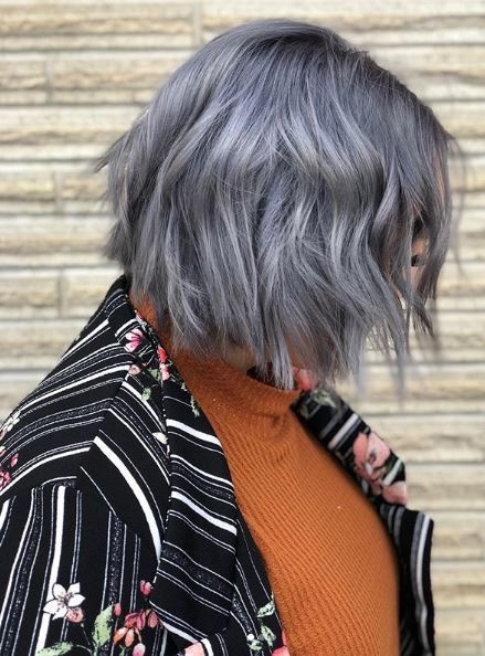 Woman with lilac wavy choppy bob