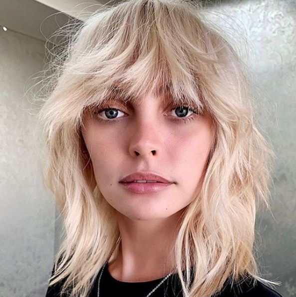 Woman with 70s syle blonde choppy bob with fringe