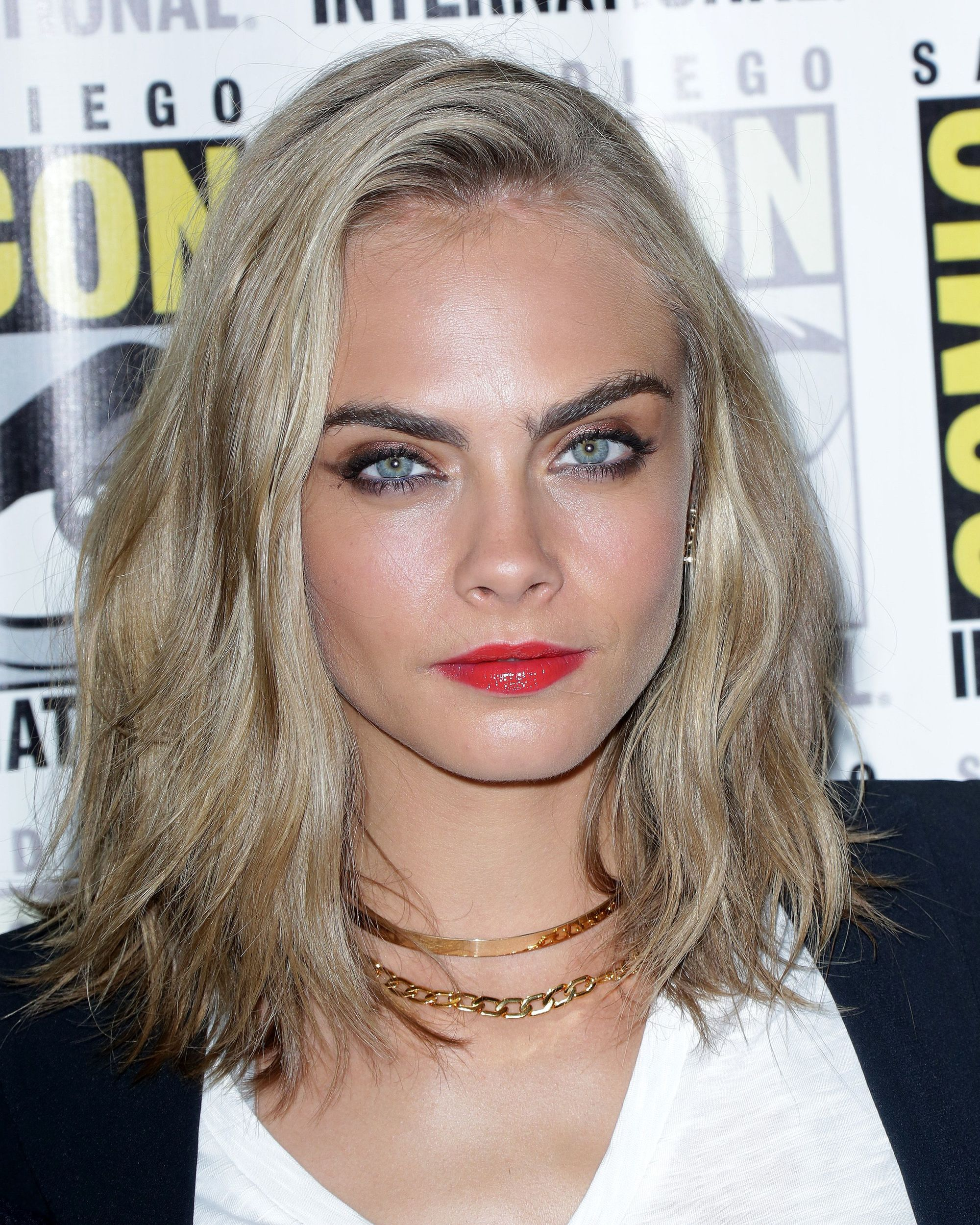 cara delevingne blonde wavy hair styled in a long choppy bob