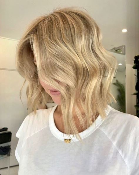 Woman with wavy blonde choppy bob