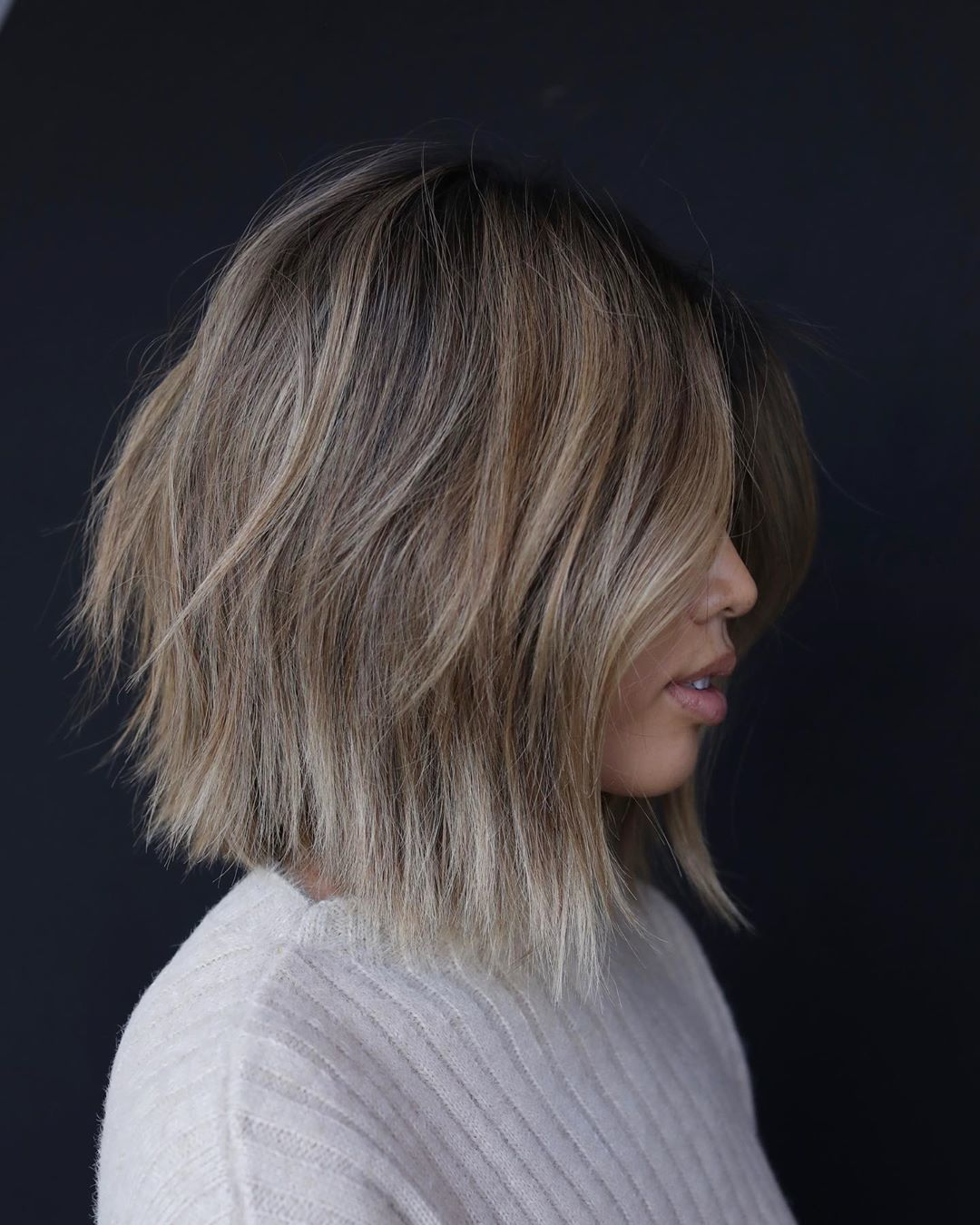 Woman with soft choppy ash brown short haircut