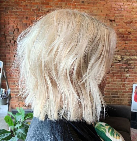 Woman with icy blonde choppy bob