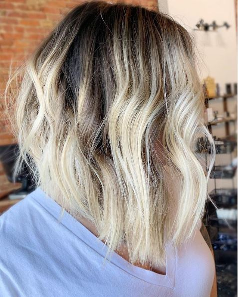 Woman with wavy ombre choppy bob