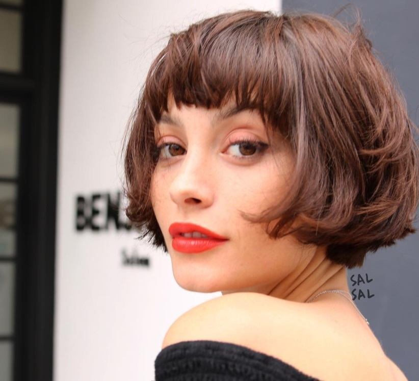 model with short choppy bob and fringe style