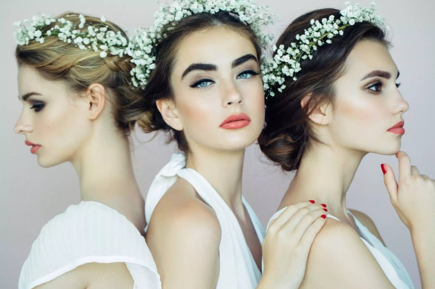 three bridal models with flower crown hair accessories