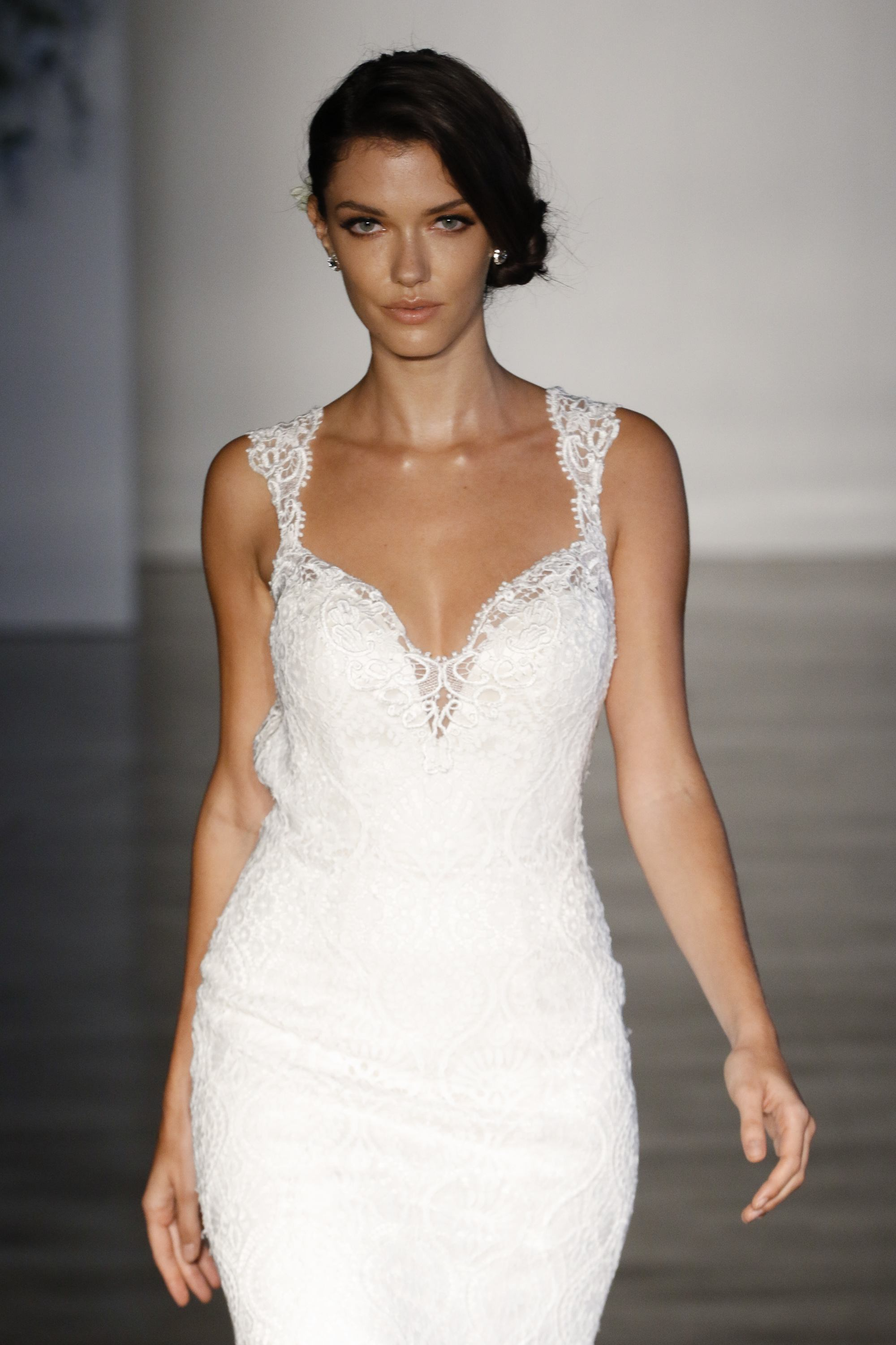 brunette bridal model on the runway with a side chignon hairstyle