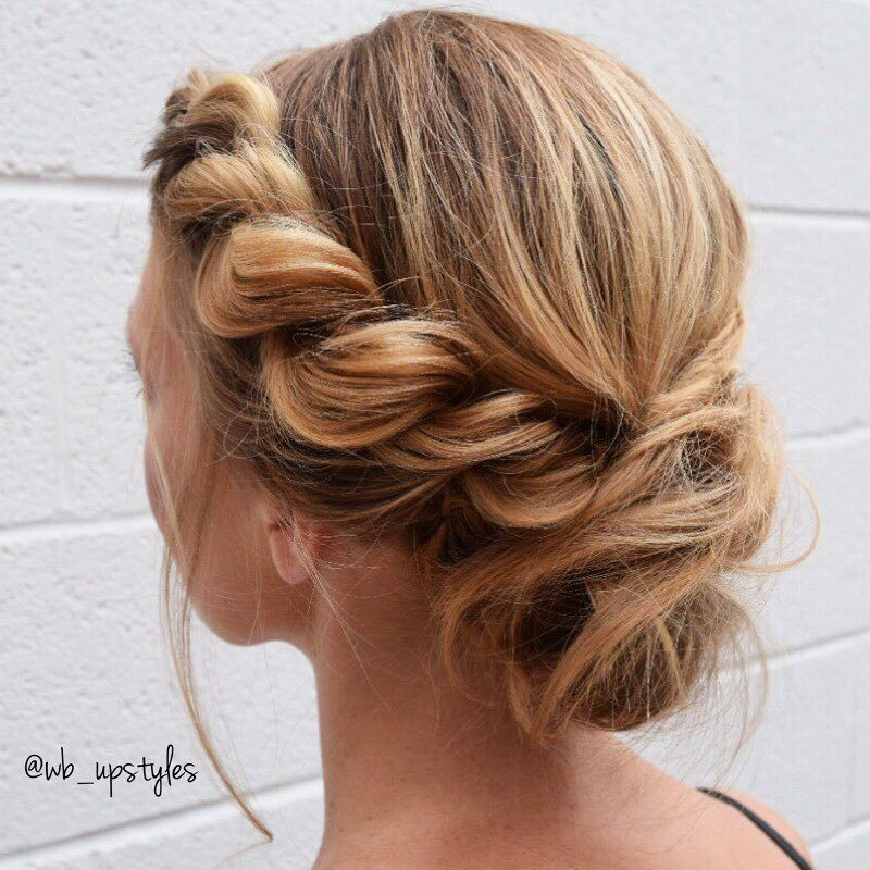 Wedding hair ideas: Woman with honey blonde hair styled into side rope braid twisted chignon