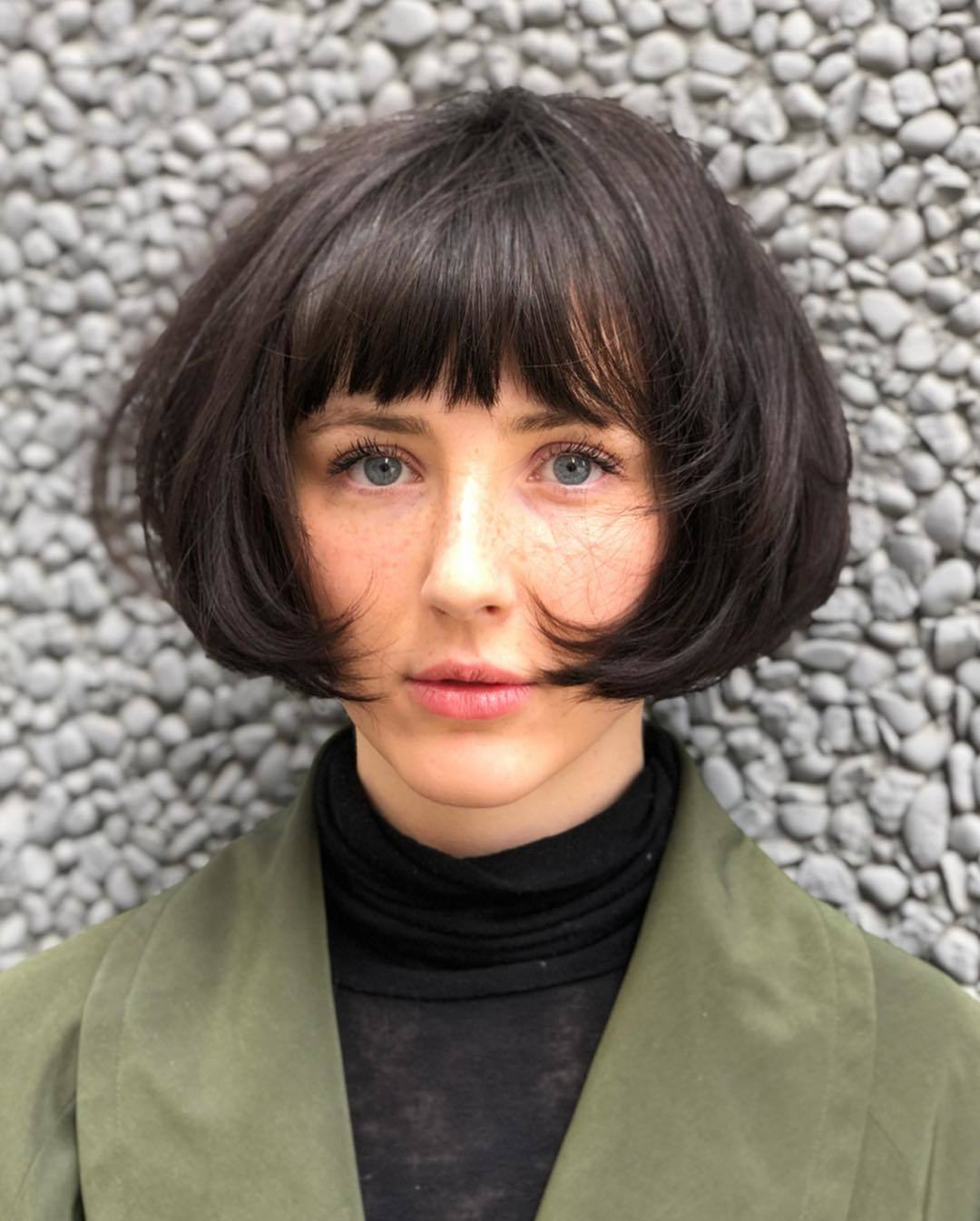 Woman with dark brown short bob with fringe