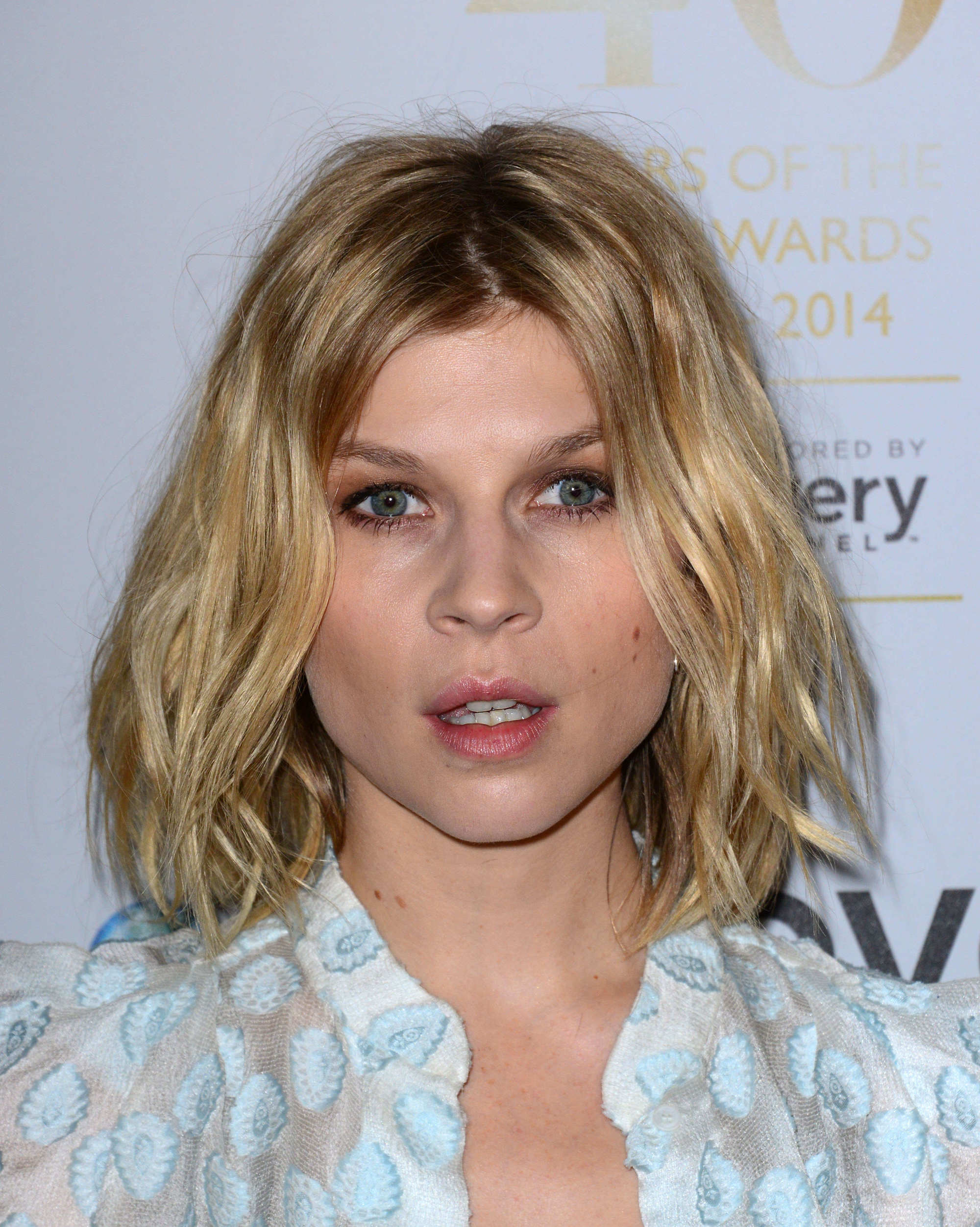 Clemence Poesy with golden, beachy short bob haircut