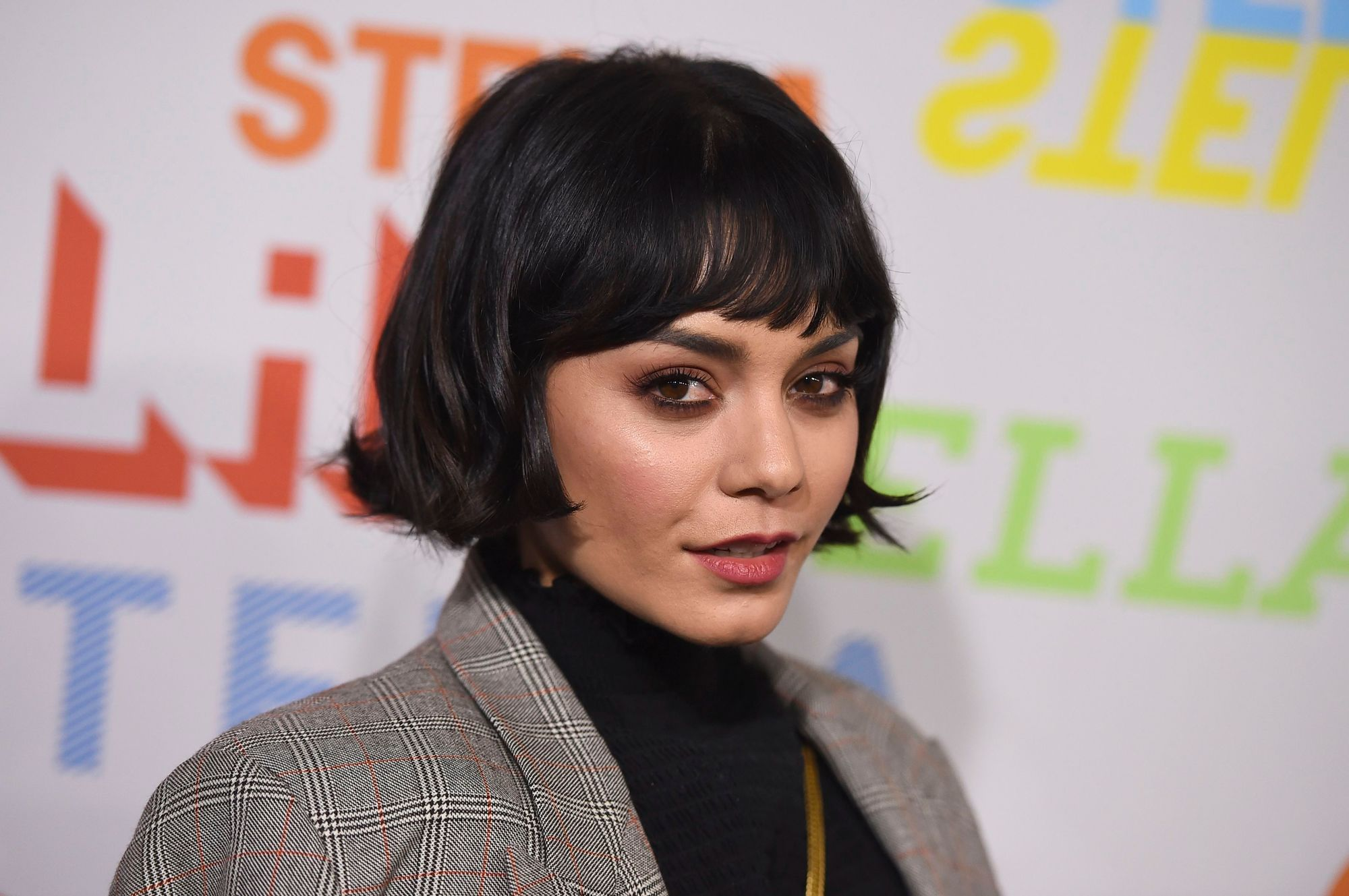 Vanessa Hudgens with short, flippy dark brown French bob haircut