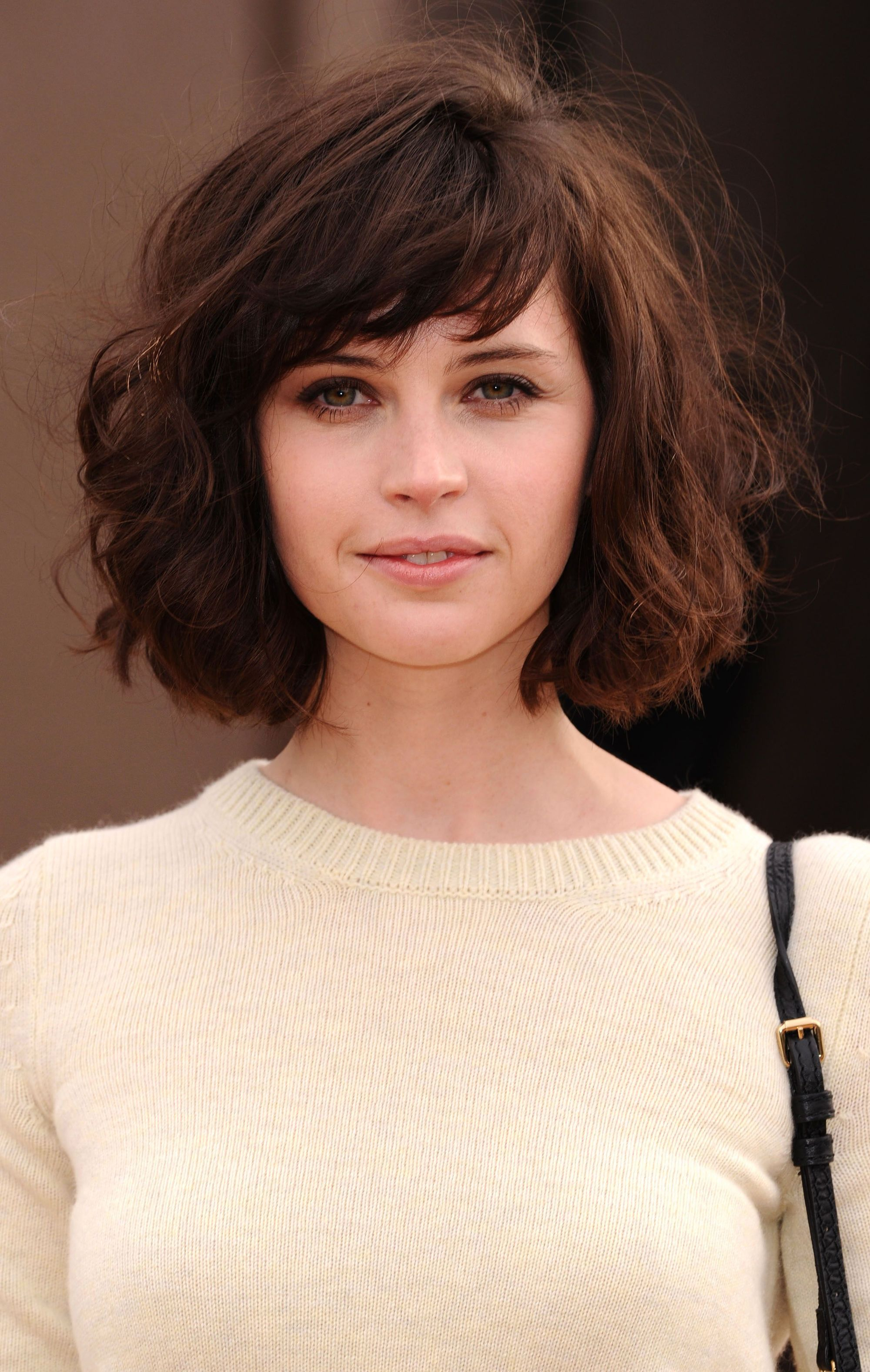 Felicity Jones with dark brown thick bob with side swept fringe