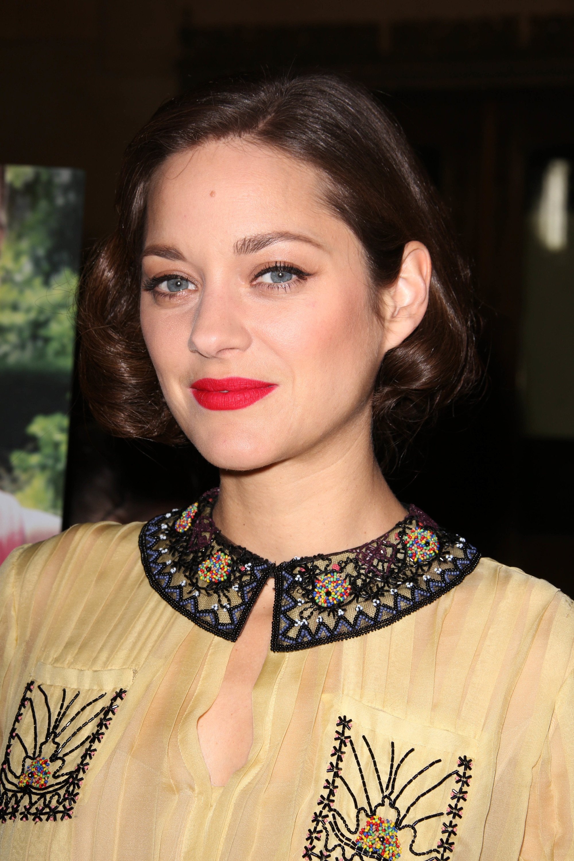 Marion Cotillard with chocolate brown curly retro bob