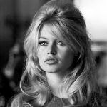 brigitte bardot with a curly half up half down hairstyle