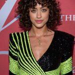 Alanna Arrington with short curly dark brown hair