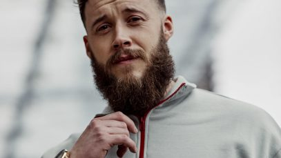 Man with short haircut and shaped beard