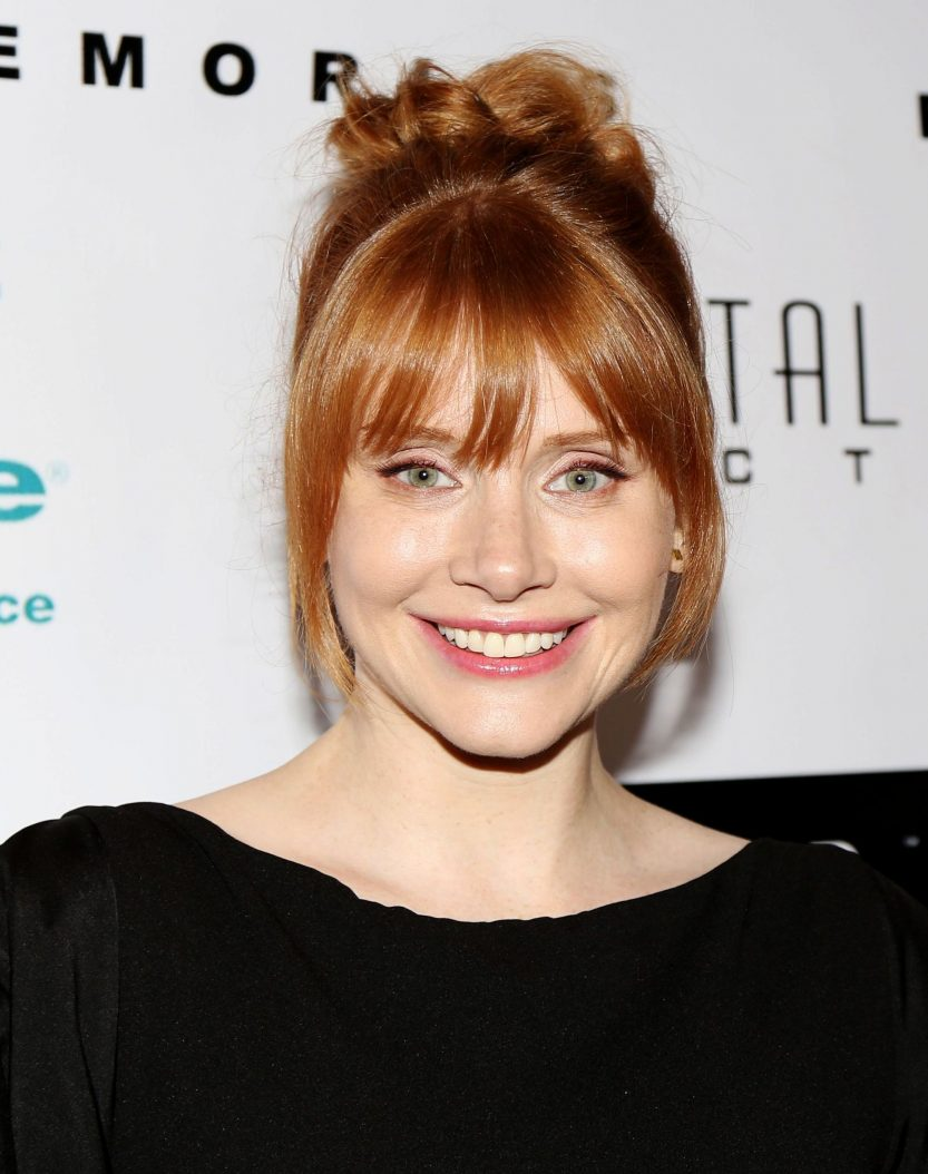 bryce dallas howard red hair in bun updo and fringe
