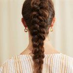 Woman with brown dutch braid