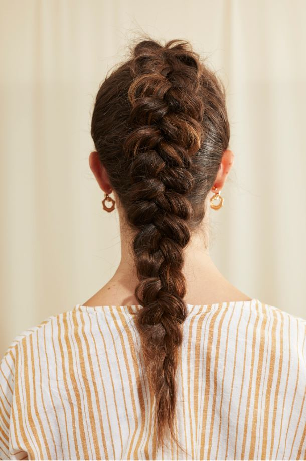 Woman with brown dutch braid