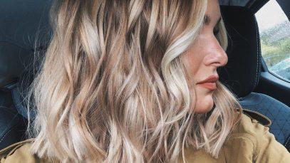Woman with a wavy blonde balayage bob