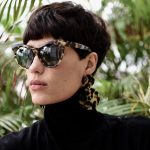Woman with textured modern bowl haircut wearing sunglasses