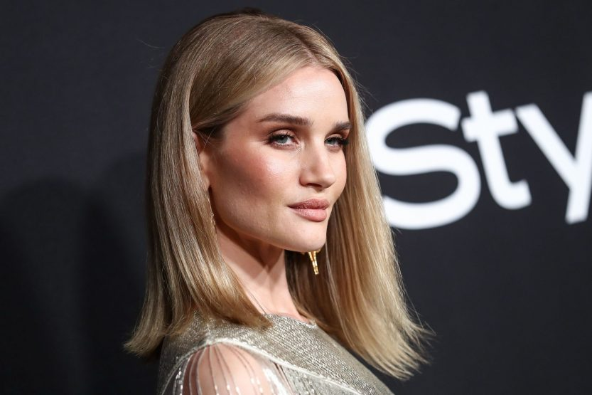Haircuts for fine straight hair: Rose Huntinton-Whiteley with medium length soft blonde hair with flicked out ends