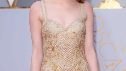 Emma Stone with deep aurburn hair in Hollywood waves