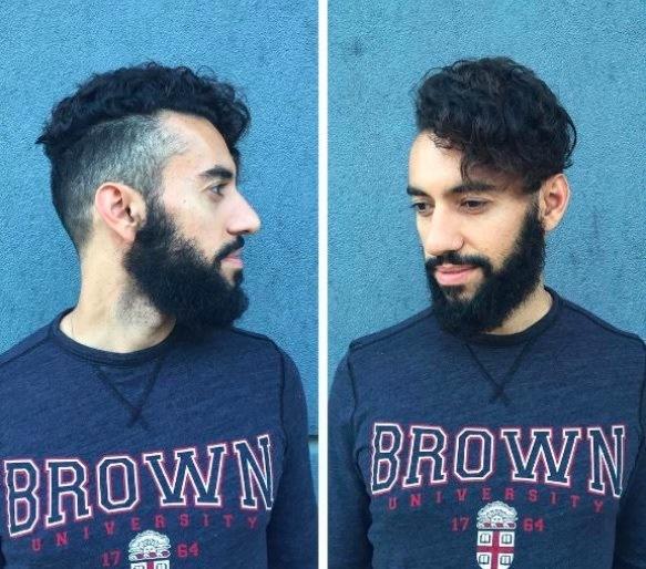 Vue de face d'un homme avec des cheveux noirs, une barbe et une coupe courte.