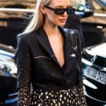 Ash blonde hair: Street style shot of woman with sleek ash blonde hair, wearing all black with sunglasses