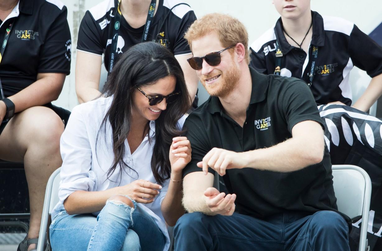 Le Prince Harry et Meghan Markle en train de rire.