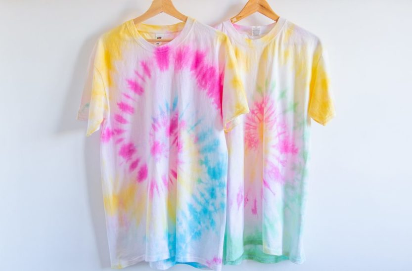 Homemade tie dye t-shirts with a spiral pattern.