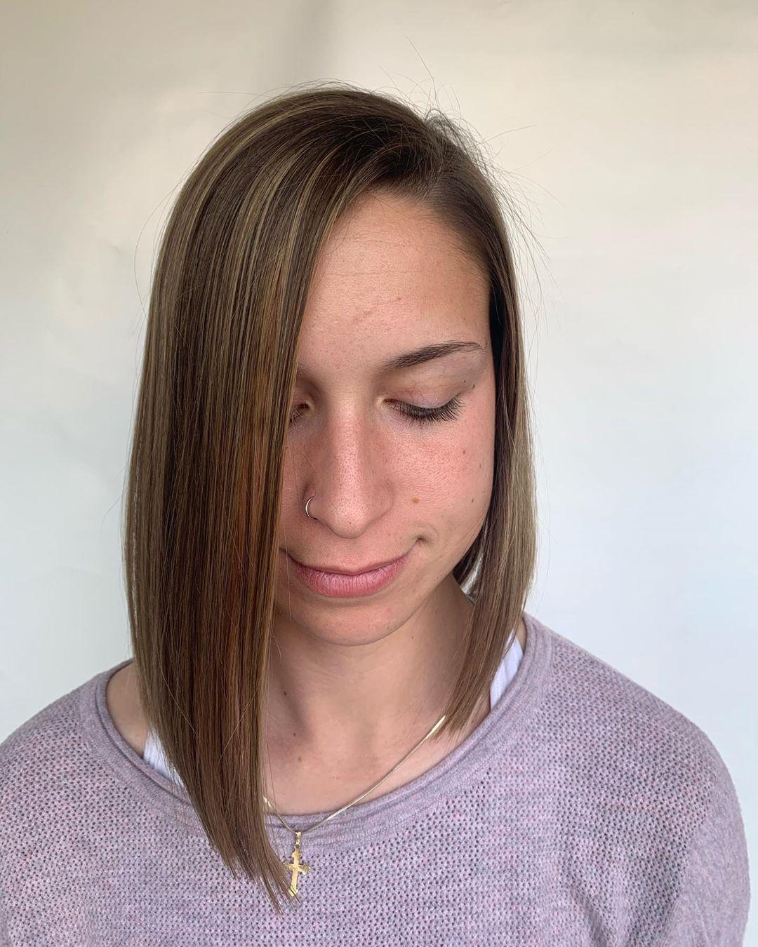 coupe de cheveux lob asymétrique et arrondie