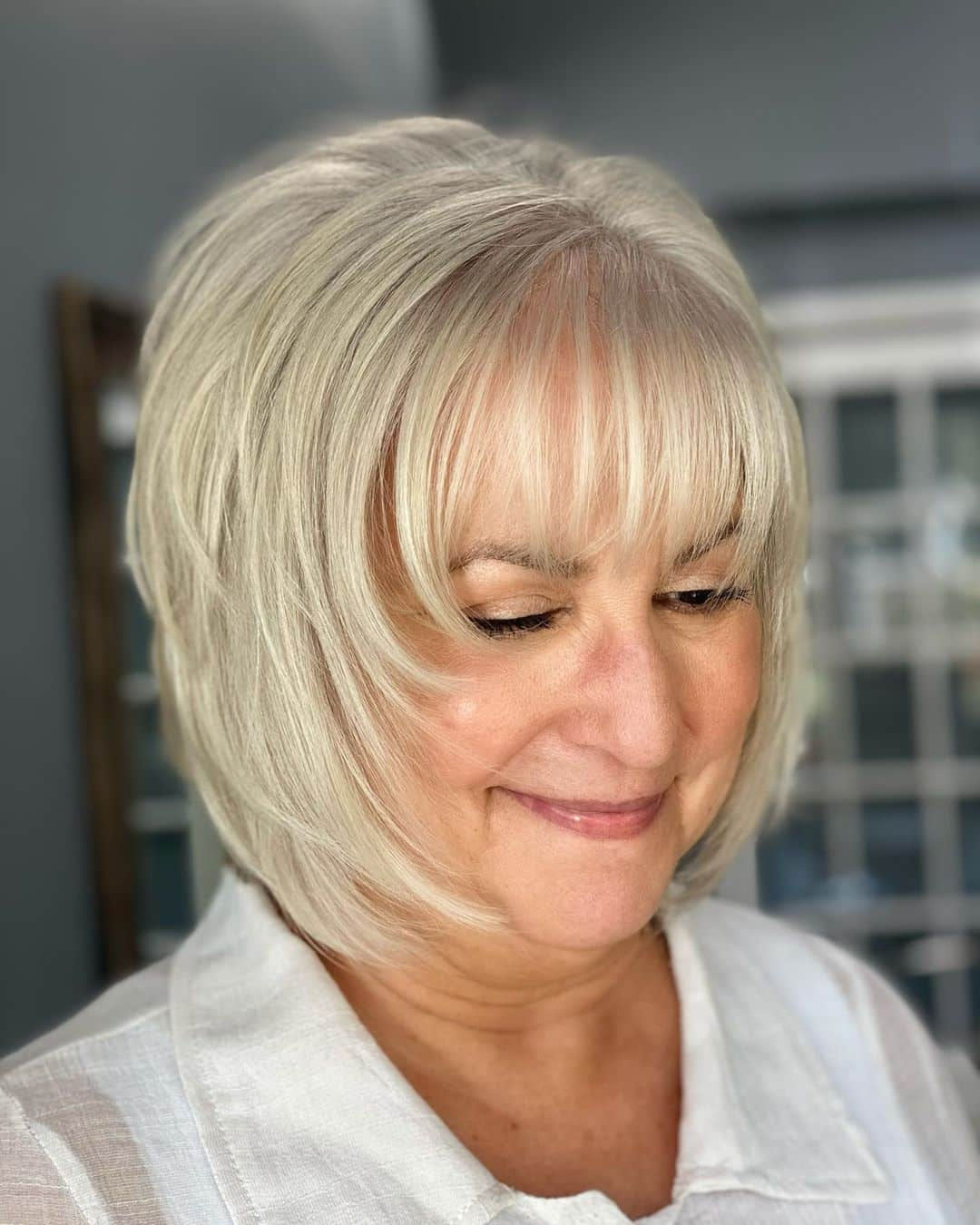 silver shaggy bob with bangs for fine hair ladies over 50