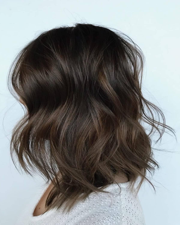 mèches brunes foncées sur cheveux noirs