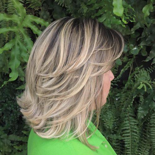 Plume blonde longueur d'épaule
