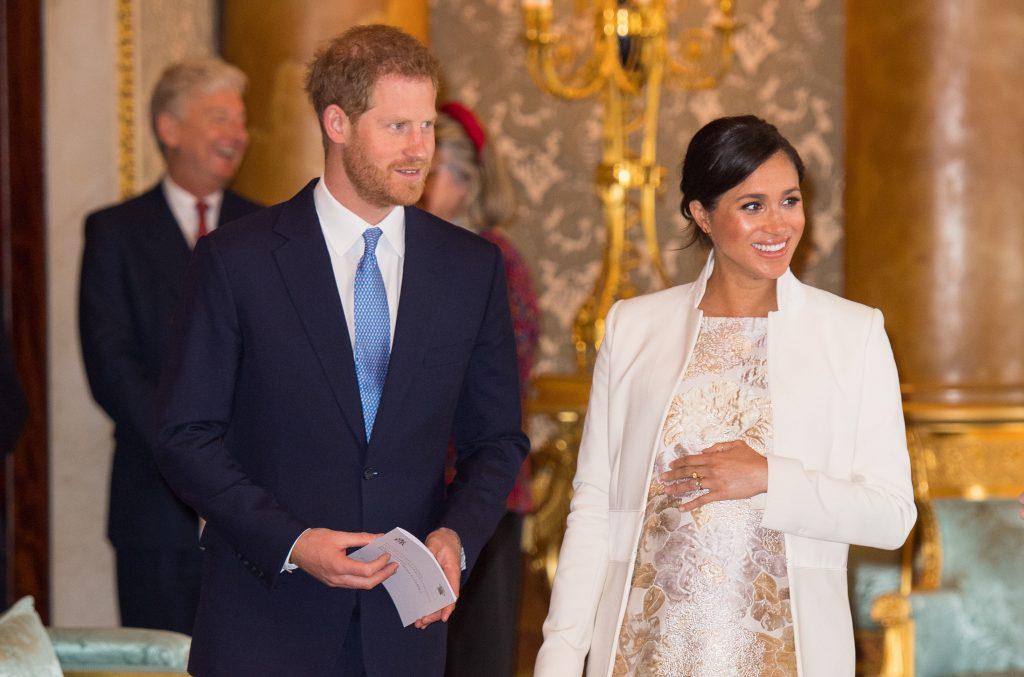 Le Prince Harry, Duc de Sussex et Meghan, Duchesse de Sussex, assistent à une réception pour marquer le 50ème anniversaire de l'investiture du Prince de Galles.