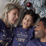 A mum, son and dad wearing matching family Christmas pyjamas